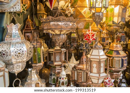 JEMMA DAR FNA, THE MAIN BAZAAR, MARRAKECH, MOROCCO, MAY 11, 2014. Lamps for sale in a shop in Jemma Dar Fna, Marrakech, Morocco, on May 11th, 2014.  - stock photo