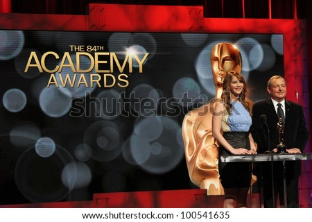 Jennifer Lawrence and Tom Sherak at the 84th Academy Awards Nominations Announcement, Academy of Motion Picture Arts and Sciences, Los Angeles, CA 01-24-12 - stock photo