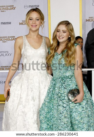 Jennifer Lawrence and Willow Shields at the Los Angeles premiere of 'The Hunger Games: Mockingjay - Part 1' held at the Nokia Theatre L.A. Live in Los Angeles on November 17, 2014. - stock photo