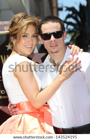 Jennifer Lopez and Casper Smart at the Jennifer Lopez Star on the Walk of Fame ceremony, Hollywood, CA 06-20-13 - stock photo