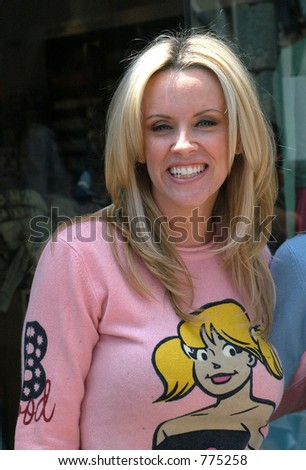 Jenny McCarthy enjoying day with friend at Kidson's. The two goofed off while waiting for there car from the valet in Beverly Hills, Ca , Los Angeles, Ca, 05/21/04 - stock photo