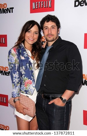 "Jenny Mollen and Jason Biggs at the ""Arrested Development"" Los Angeles Premiere, Chinese Theater, Hollywood, CA 04-29-13 - stock photo"