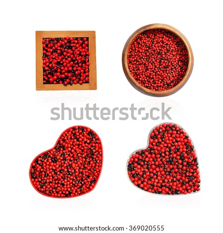 Jequirity seeds red and black in wooden bowl isolated on white background. This has clipping path.