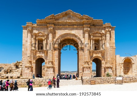 JERASH, JORDAN - MAY 2, 2014: Arch of Hadrian, built to honor the visit of emperor Hadrian to Jerash. Ancient Roman city of Gerasa reached a size of about 800,000 square meters within its walls.
