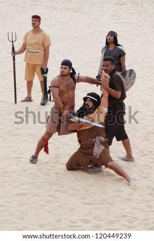 JERASH - JORDAN - NOVEMBER 25: Jordanian men dress as Roman gladiators during a roman circus reenactment show on November 25, 2009 in Jerash, Jordan - stock photo