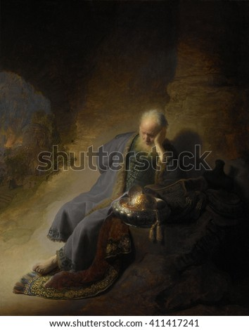 Jeremiah Lamenting the Destruction of Jerusalem, by Rembrandt, 1628, Dutch painting, oil on panel. Biblical prophet Jeremiah sits outdoors with a golden bowl, carpet and books, apparently objects sav - stock photo