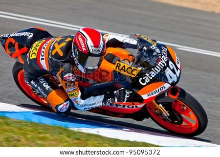 JEREZ DE LA FRONTERA, SPAIN - APR 17: 125cc motorcyclist Alex Rins takes a curve in the CEV Championship race on April 17, 2011 in Jerez de la Frontera, Spain. - stock photo