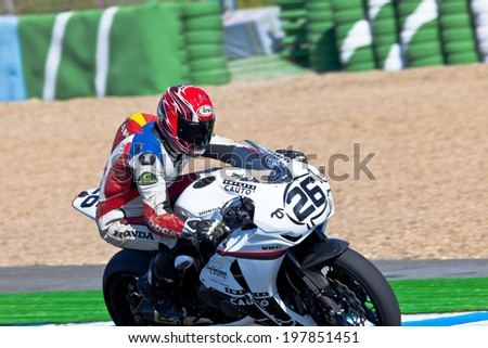 JEREZ DE LA FRONTERA, SPAIN - APR 16: Stock Extreme motorcyclist Adrian Gandara Gutierrez takes a curve in the CEV Championship race on April 16, 2011 in Jerez de la Frontera, Spain - stock photo