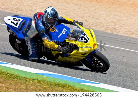 JEREZ DE LA FRONTERA, SPAIN - APR 17: Stock Extreme motorcyclist Jorge Arroyo takes a curve in the CEV Championship race on April 17, 2011 in Jerez de la Frontera, Spain - stock photo