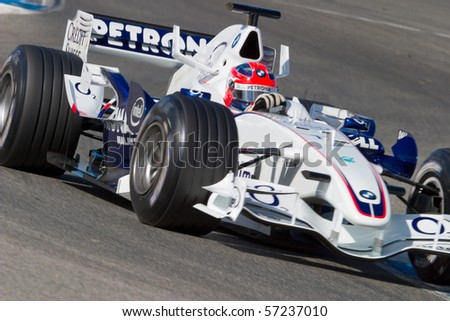JEREZ DE LA FRONTERA, SPAIN - CIRCA 2006 : Robert Kubica of BMW-Sauber F1 on training circa 2006 in Jerez de la Frontera, Spain. - stock photo