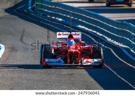JEREZ DE LA FRONTERA, SPAIN - FEB 10: Fernando Alonso of Scuderia Ferrari F1 leaving the pit on training session on February 10 , 2012, in Jerez de la Frontera , Spain - stock photo