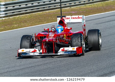 JEREZ DE LA FRONTERA, SPAIN - FEB 10: Fernando Alonso of Scuderia Ferrari F1 races on training session on February 10 , 2012, in Jerez de la Frontera , Spain - stock photo