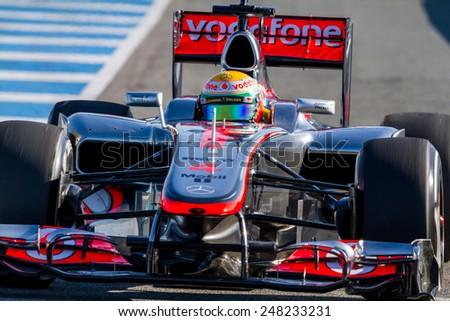 JEREZ DE LA FRONTERA, SPAIN - FEB 10: Lewis Hamilton of McLaren F1 leaving the pit on training session on February 10 , 2012, in Jerez de la Frontera , Spain - stock photo
