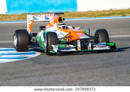 JEREZ DE LA FRONTERA, SPAIN - FEB 10: Nico H���¼lkenberg of Force India F1 races on training session on February 10 , 2012, in Jerez de la Frontera , Spain - stock photo