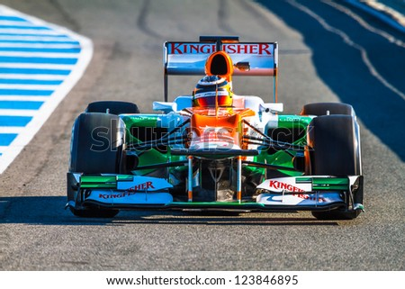JEREZ DE LA FRONTERA, SPAIN - FEB 10: Nico Hulkenberg of Force India F1 leaving the pit on training session on February 10 , 2012, in Jerez de la Frontera , Spain - stock photo