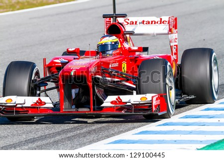 JEREZ DE LA FRONTERA, SPAIN - FEB 08: Pedro Martinez de la Rosa of Scuderia Ferrari F1 races on training session on February 08 , 2013, in Jerez de la Frontera , Spain - stock photo