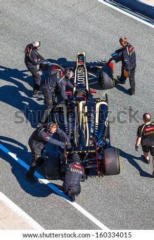 JEREZ DE LA FRONTERA, SPAIN - FEB 10: Romain Grosjean of Lotus Renault F1 entering to the pit on training session on February 10 , 2012, in Jerez de la Frontera , Spain - stock photo