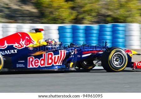JEREZ DE LA FRONTERA, SPAIN - FEB 09: Sebastian Vettel of Red Bull Racing team drives his F1 car during training session at Jerez circuit on February 09, 2012, in Jerez de la Frontera , Spain - stock photo