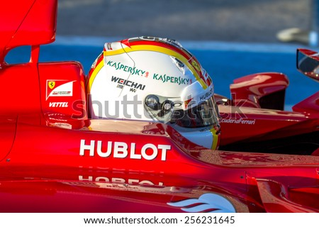 JEREZ DE LA FRONTERA, SPAIN - FEB 01:  Sebastian Vettel of Scuderia Ferrari F1 leaving pits  on training session on February 01 , 2015, in Jerez de la Frontera , Spain - stock photo