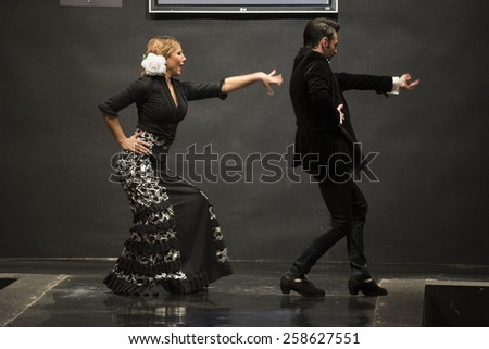 JEREZ DE LA FRONTERA, SPAIN - FEBRUARY 14: Flamenco dancers on the catwalk during the Carmen Rojo Flamenca season fashion show at Pasarela Flamenca Jerez on feb 14, 2015 in Jerez de la frontera.