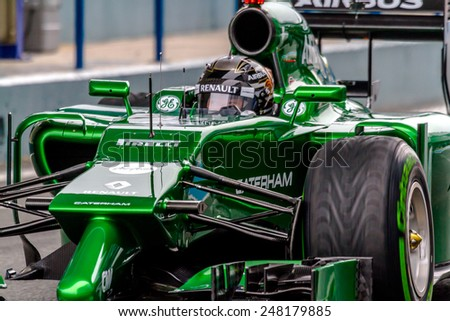 JEREZ DE LA FRONTERA, SPAIN - JAN 31: Kamui Kobayashi of Caterham F1 leaving the pit on training session on January 31 , 2014, in Jerez de la Frontera, Spain - stock photo