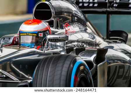 JEREZ DE LA FRONTERA, SPAIN - JAN 31: Kevin Magnussen of McLaren Mercedes F1 leaving the pit on training session on January 31 , 2014, in Jerez de la Frontera , Spain - stock photo