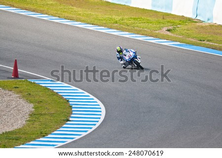JEREZ DE LA FRONTERA, SPAIN - MAR 5:125cc pilot Sergio Gadea races on the official training of the world championship of MotoGP on Mar 5, 2011, in racetrack of velocity of Jerez de la Frontera, Spain - stock photo