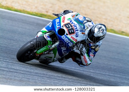 JEREZ DE LA FRONTERA, SPAIN - MAR 25: MotoGP motorcyclist Yonny Hernandez takes a curve in the MotoGP Official Trainnig on March 25, 2012 in Jerez de la Frontera, Spain - stock photo