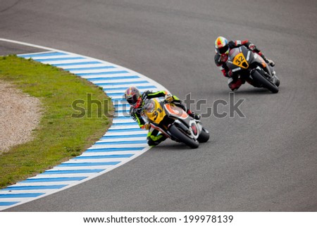 JEREZ DE LA FRONTERA, SPAIN - NOV 20: MOTO2 motorcyclist Carmelo Morales and Alejandro Martinez takes a curve in the CEV championship on Nov 20, 2010, in Jerez de la Frontera, Spain - stock photo