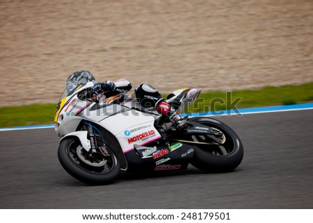JEREZ DE LA FRONTERA, SPAIN - NOV 20: MOTO2 motorcyclist Daniel Arcas takes a curve in the CEV championship on Nov 20, 2010, in Jerez de la Frontera, Spain - stock photo