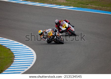 JEREZ DE LA FRONTERA, SPAIN - NOV 20: MOTO2 motorcyclist Ivan Silva and Luis Miguel Mora takes a curve in the CEV championship on Nov 20, 2010, in Jerez de la Frontera, Spain - stock photo