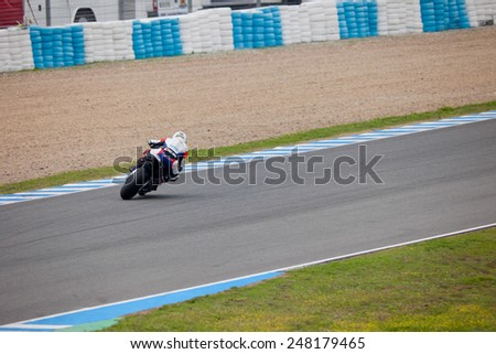 JEREZ DE LA FRONTERA, SPAIN - NOV 20: Stock Extreme motorcyclist Alejandro Mari���±elarena  takes a curve in the CEV championship on Nov 20, 2010, in Jerez de la Frontera, Spain - stock photo