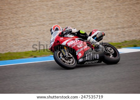 JEREZ DE LA FRONTERA, SPAIN - NOV 20: Stock Extreme motorcyclist Xavier Del Amor takes a curve in the CEV championship on Nov 20, 2010, in Jerez de la Frontera, Spain - stock photo