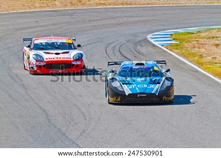 JEREZ DE LA FRONTERA, SPAIN - OCT 16: Ferran Monje(4) followed by Francesc Gutierrez(42)races on Iber GT championship on October 16 , 2011, in Jerez de la Frontera , Spain - stock photo