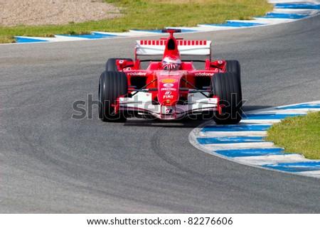 JEREZ DE LA FRONTERA, SPAIN - OCT 10: Marc Gene of Scuderia Ferrari F1 take a curve on training session on October 10 , 2006 in Jerez de la Frontera , Spain - stock photo