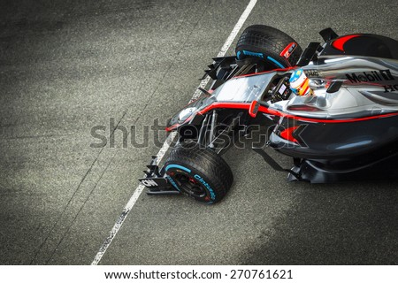JEREZ, SPAIN - FEBRUARY 2ND: Fernando Alonso testing his new Mclaren Honda MP4-30 F1 car on the first Test at the Jerez Circuit in Jerez, Andalucia, Spain on Feb. 2, 2015. - stock photo