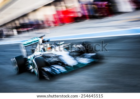 JEREZ, SPAIN - FEBRUARY 2ND: Lewis Hamilton testing his new Mercedes W06 F1 car on the first Test at the Jerez Circuit in Jerez, Andalucia, Spain on Feb. 2, 2015. - stock photo