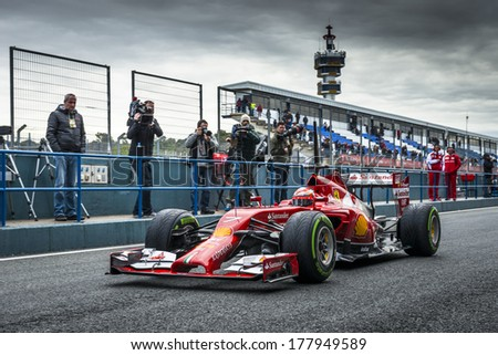 JEREZ, SPAIN - JANUARY 31: Kimi Raikkonen testing his new Ferrari F14 T F1 car on the first Test at the Jerez Circuit in Jerez, Andalucia, Spain on Jan. 31, 2014. - stock photo