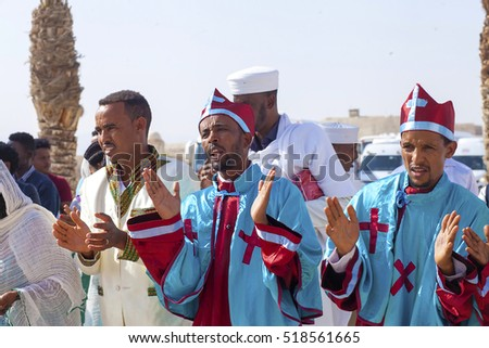 JERICHO, ISRAEL - NOV 12, 2016: Ethiopian pilgrims in ritual clothes clap hands while singing during a visit of Qasr el Yahud, the Baptismal site on Jordan river.