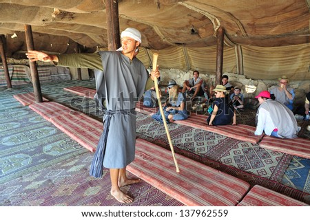 JERICHO - SEP 17:Tourist in Israeli nomad tent on September 17 2008 in the Judean Desert, Israel.It's a rain shadow desert located between Jerusalem to Jericho 85 miles long and 25 miles wide. - stock photo