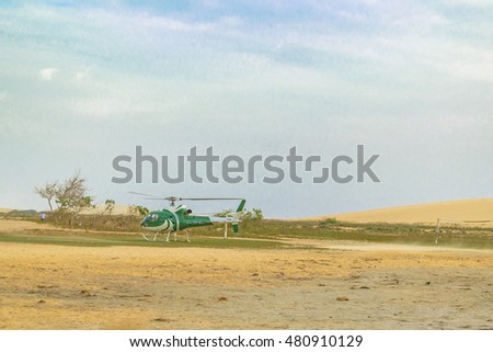 JERICOACOARA, BRAZIL, DECEMBER - 2015 - Side view of helicopter parked at beach in Jericoacoara Brazil