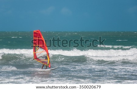 Jericoacoara, Ceara, Brazil - December 10, 2015 : Unidentified windsurfer riding on the waves in Atlantic ocean, documentary editorial.