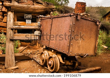Jerome Arizona Ghost Town mine car and sign - stock photo