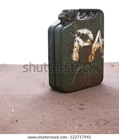 jerry can on sand with white background for copy - stock photo
