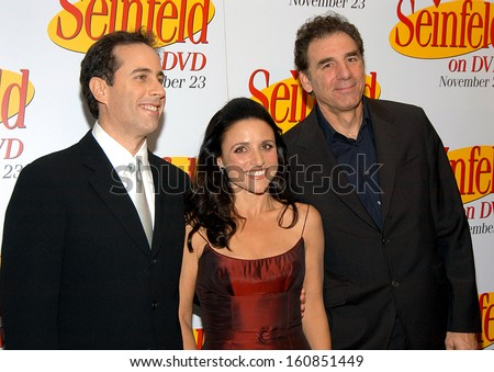 Jerry Seinfeld, Julia Louis-Dreyfus, and Michael Richards at the celebration for the release of the SEINFELD DVD at the Rainbow Room, New York, November 17, 2004 - stock photo