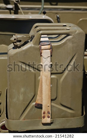 jerrycan with engine fuel at the back an oldtimer army jeep - stock photo