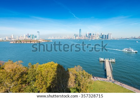 Jersey City and Manhattan as seen from Statue of Liberty. - stock photo