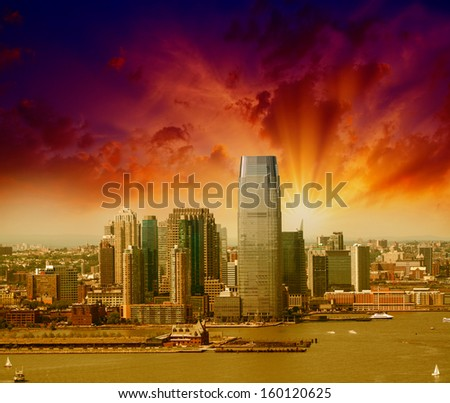 Jersey City, New Jersey. Beautiful skyline view from helicopter at sunset. - stock photo