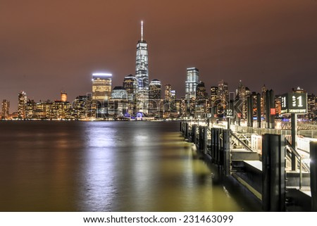 JERSEY CITY, NEW JERSEY - NOVEMBER 8, 2014: New York City Manhattan skyline at night over Hudson River viewed from New Jersey - stock photo