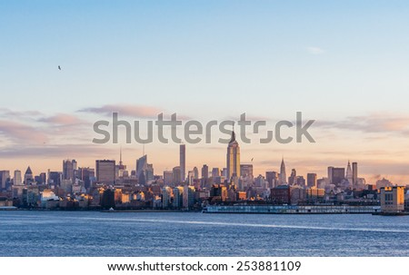 Jersey City - NJ 30 dec 2014: manhattan skyline view from harborside hudson river at dawn time in jersey city - stock photo